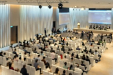 Abstract blurred photo of conference hall or seminar room with attendee background from top view, business and education concept