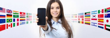 cheerful smiling woman showing blank smartphone screen