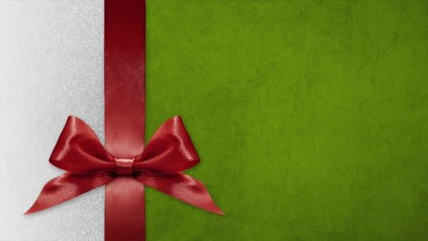 Veselé Vánoce dárková karta, mašle luky změnit barvy izolované na Vánoce lesklé pozadí šablony s kopií prostoru
