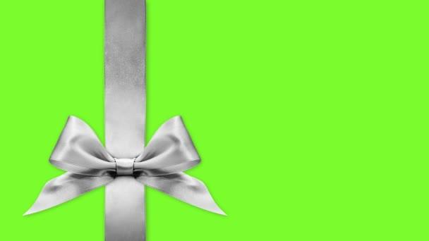 černá pátek dárková karta, mašle luky měnit barvy izolované na zelené obrazovce pozadí šablony s kopírovacím prostorem