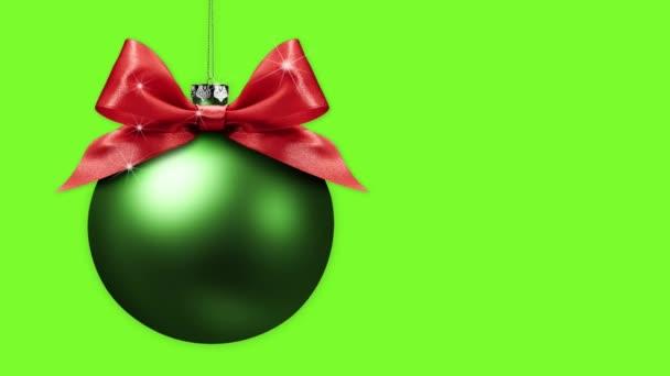Veselé vánoční stromeček koule s mašlí luky změnit barvy izolované na zeleném pozadí obrazovky