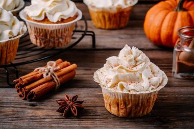 Pumpkin cupcakes decorated with cream cheese frosting