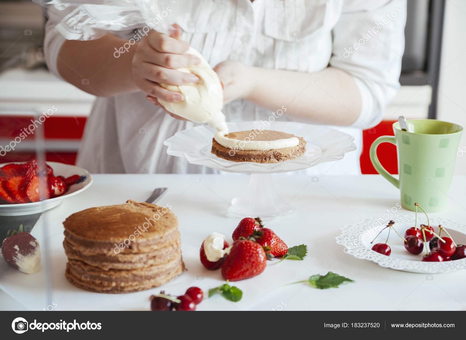 Woman Making The Naked Cake — Stock Photo © NatashaPhoto #183237520