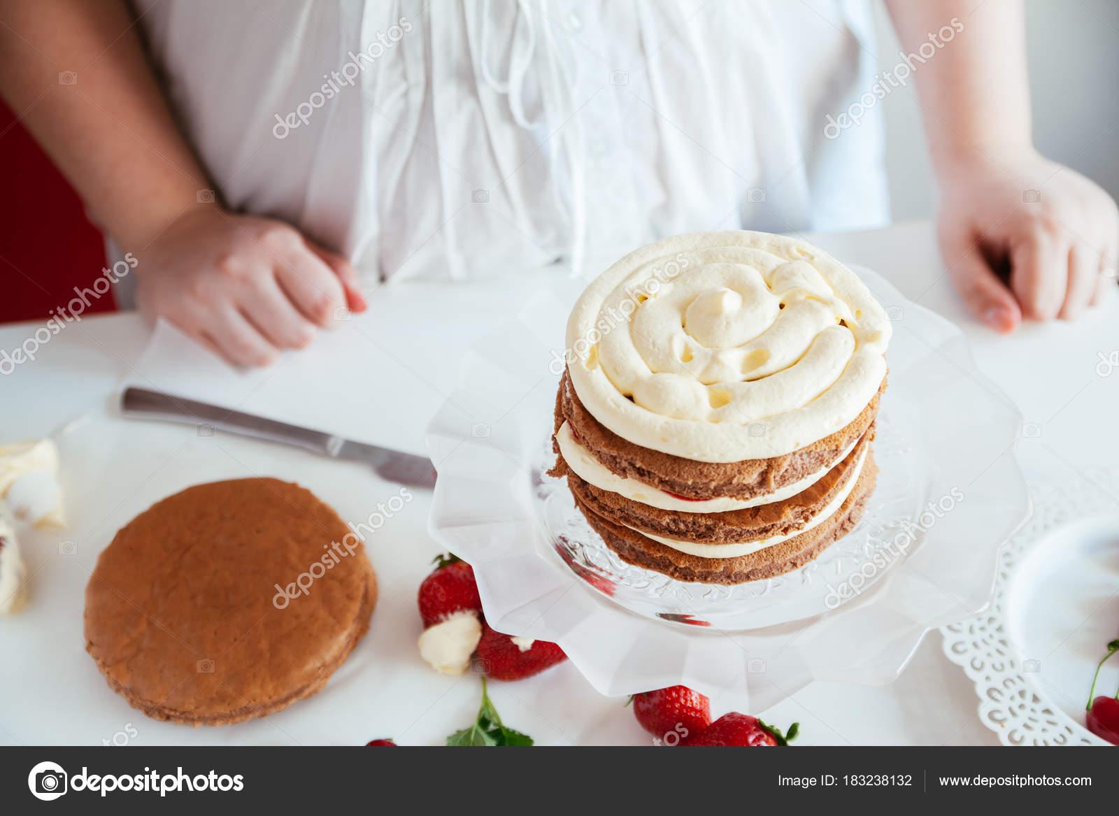 Woman Making The Naked Cake — Stock Photo © NatashaPhoto #183238132