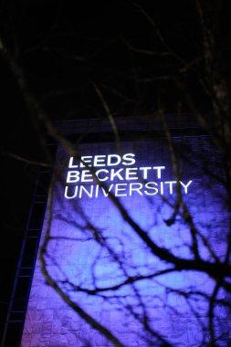Close up shot behind a tree of Leeds Beckett University