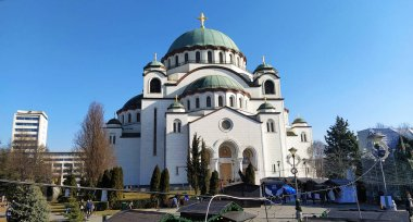 Belgrade, Serbia - February 14, 2020 Temple of St. Sava in Belgrade in the afternoon in sunny weather. Religious large building in neo-Byzantine style. White marmore facade.