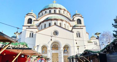 Belgrade / Serbia - February 14, 2020: Temple of St. Sava in Belgrade in the afternoon in sunny weather. Religious large building in neo-Byzantine style. White marmore facade.
