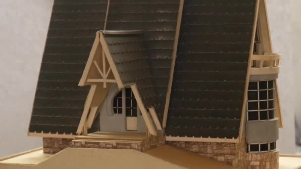 Giving a house key on the cottage model background