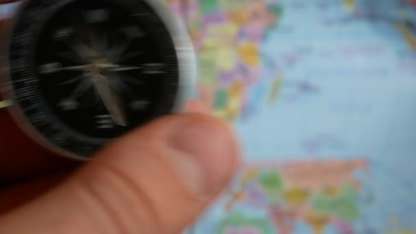 Compass and map in male hands