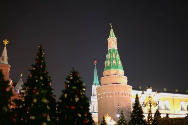 Christmas decorations on the street on the background of the Moscow Kremlin. Manezhnaya Square