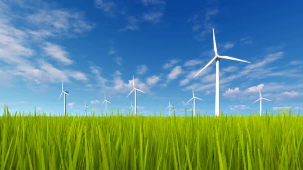 Rotating wind turbines and green grass field