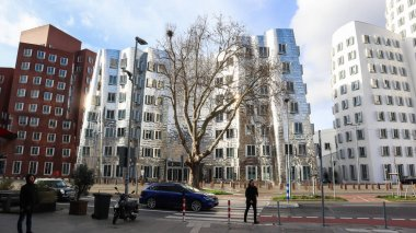 Dusseldorf, Germany - February 20, 2020. Modern building in the Neuer Zollhof district. Facade of modern architecture and beautiful design of the house. A closeup view of Frank Gehry buildings