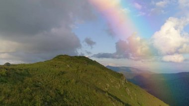 The flight above the mountain on the cloud stream background. Hyperlapse Image.