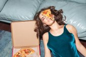 Fotografie pretty woman with pizza on her face