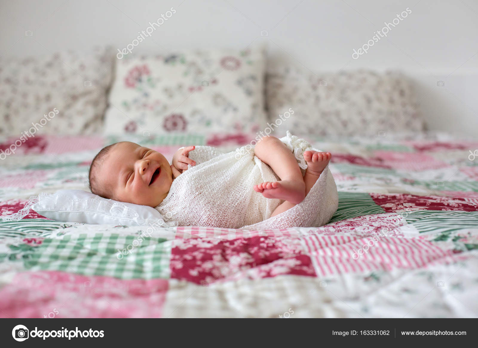 Beautiful Newborn Baby Boy Widely Smiling Wrapped In Wrap Lyi