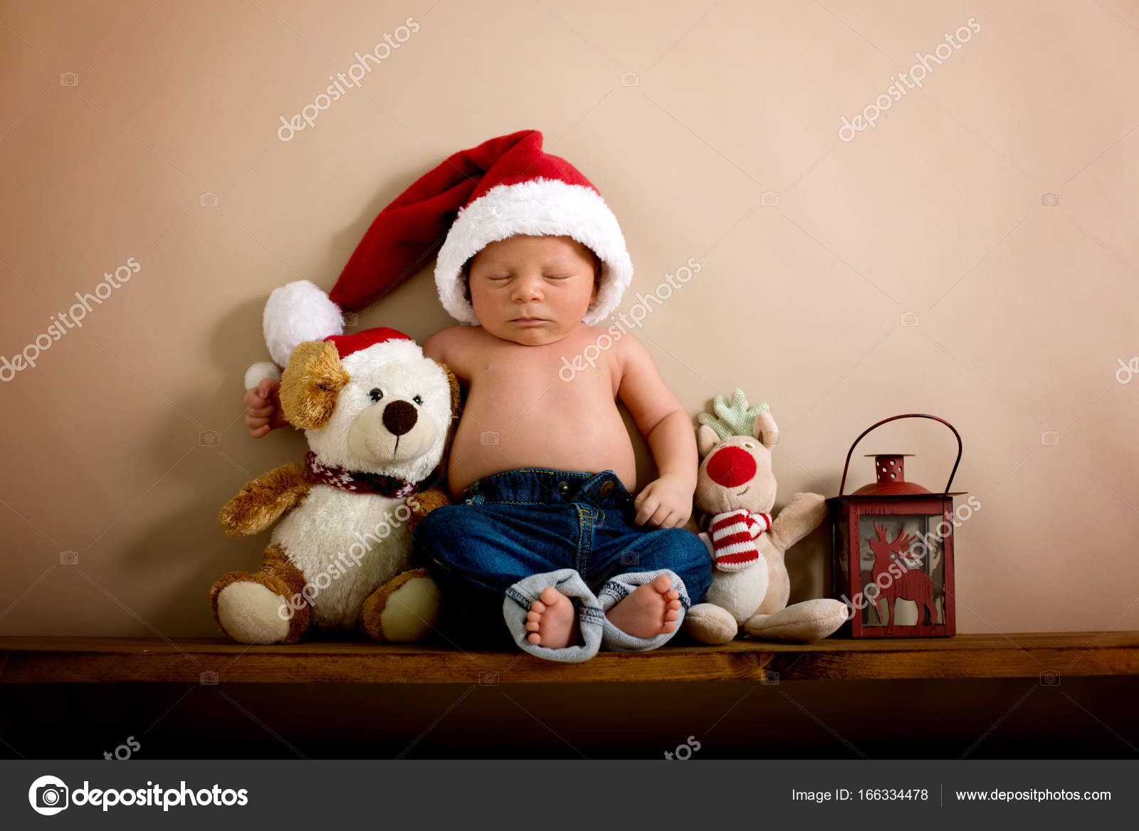c01d0d241e8bf Newborn baby boy wearing a christmas hat and jeans