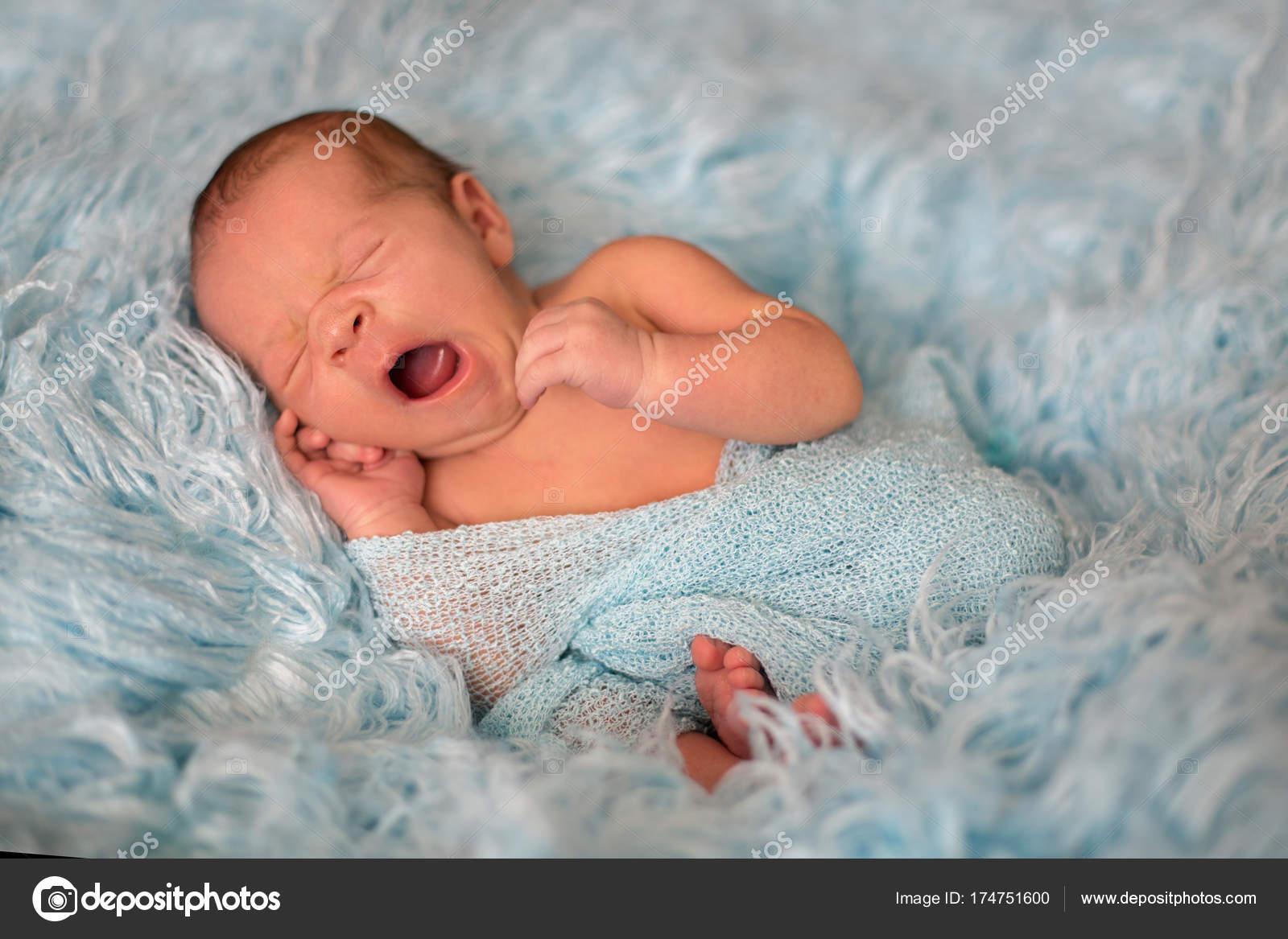96cf00b1778 Happy smiling newborn baby in wrap