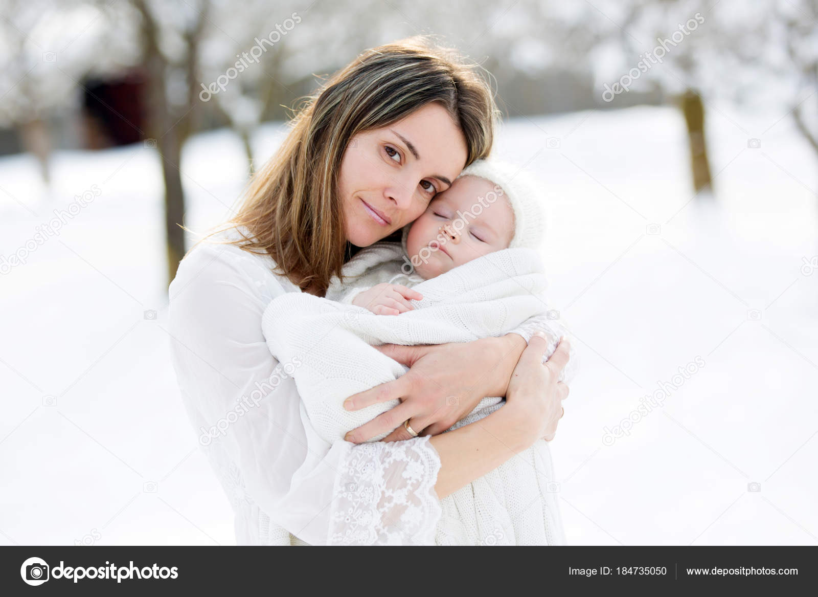 788ffffff Beautiful mother in white dress and cute baby boy in knitted one ...