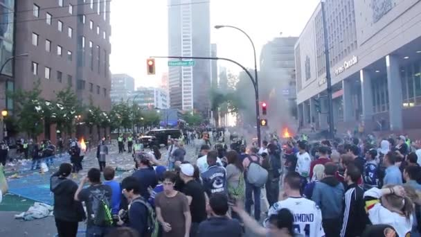 Objects and bottles thrown towards police in riot aftermath in Canada