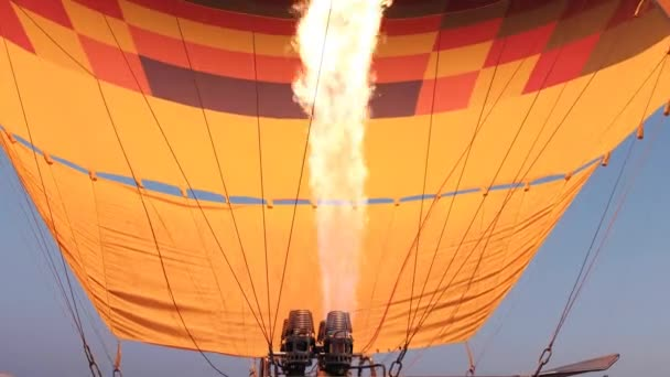 Hot air balloon preparing for the flight with propane gas heat in Goreme, Cappadocia Turkey.