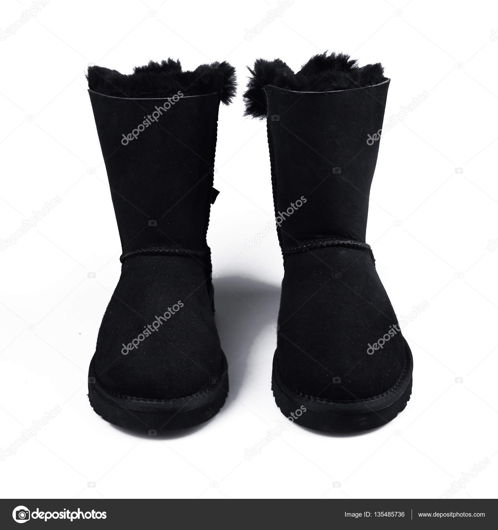 13b0a24b82ba Australian black Trendy winter shoes. Fur women s boots on white background  — Photo by Martyna1802