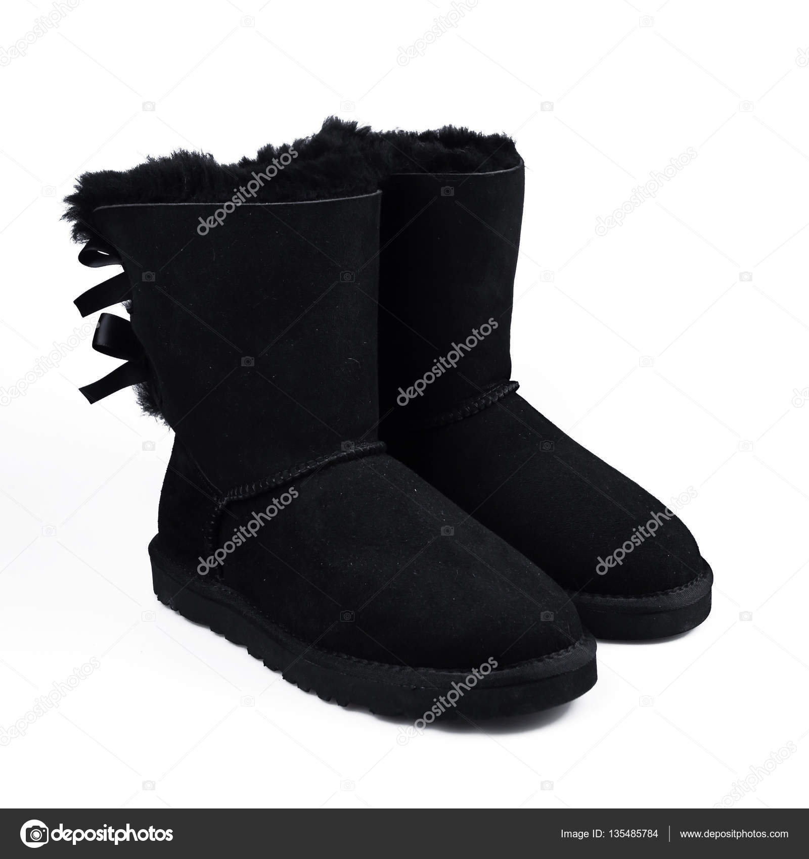 1bc0f8fcf61c Australian black Trendy winter shoes. Fur women s boots on white background  — Photo by ...