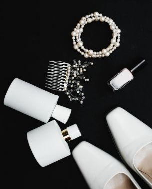 Stylish female accessories.white Shoes with perfume and accessor