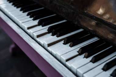 Broken piano keys of an old classic acoustic piano