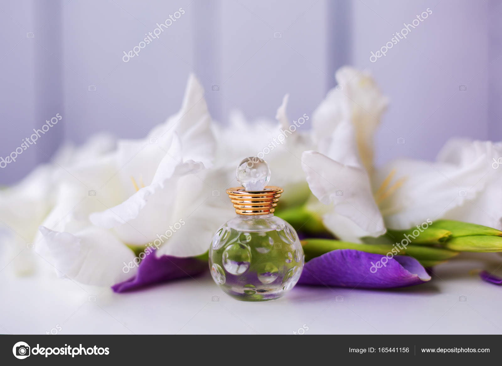 Small Bottle Of Perfume With White Flowers Stock Photo