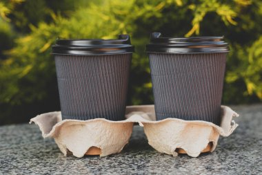 take away coffee at nature background