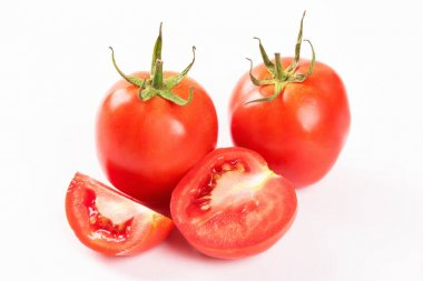 Tomato with slice and half isolated on white background.