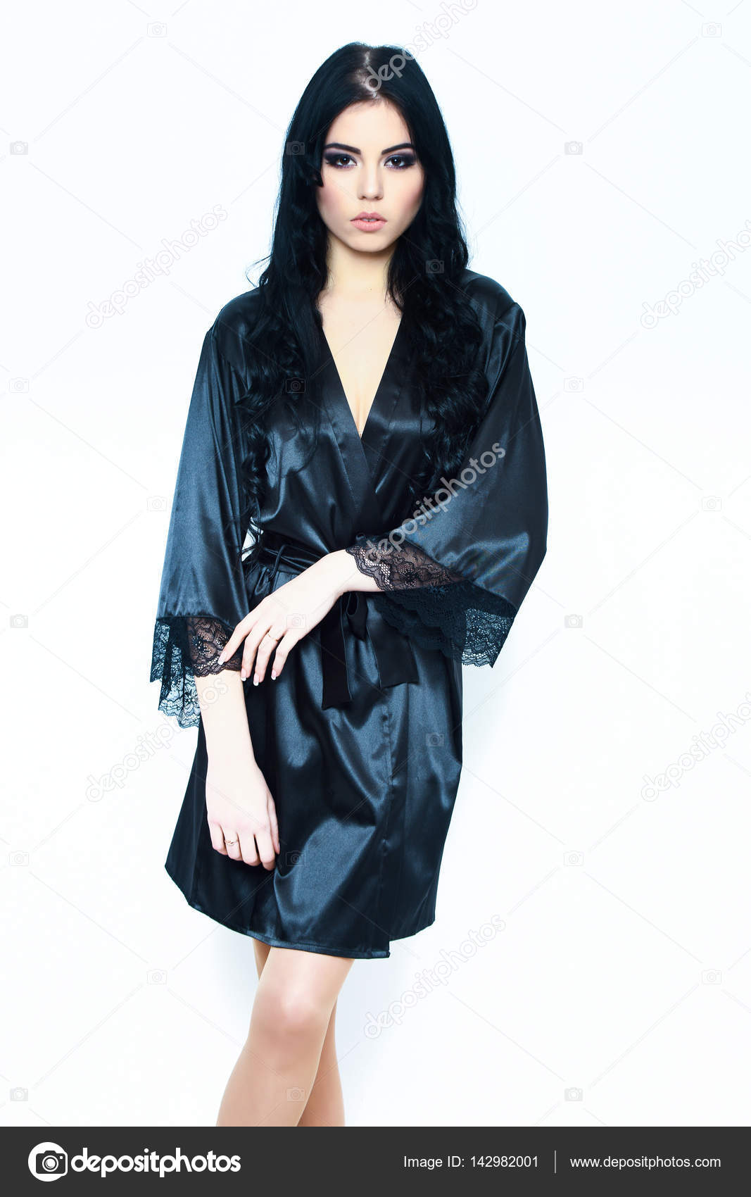a119c3bb93 Pretty cute sexy girl or beautiful woman with fashion makeup on serious face  and curly long hair in black silk robe isolated on white background — Photo  by ...
