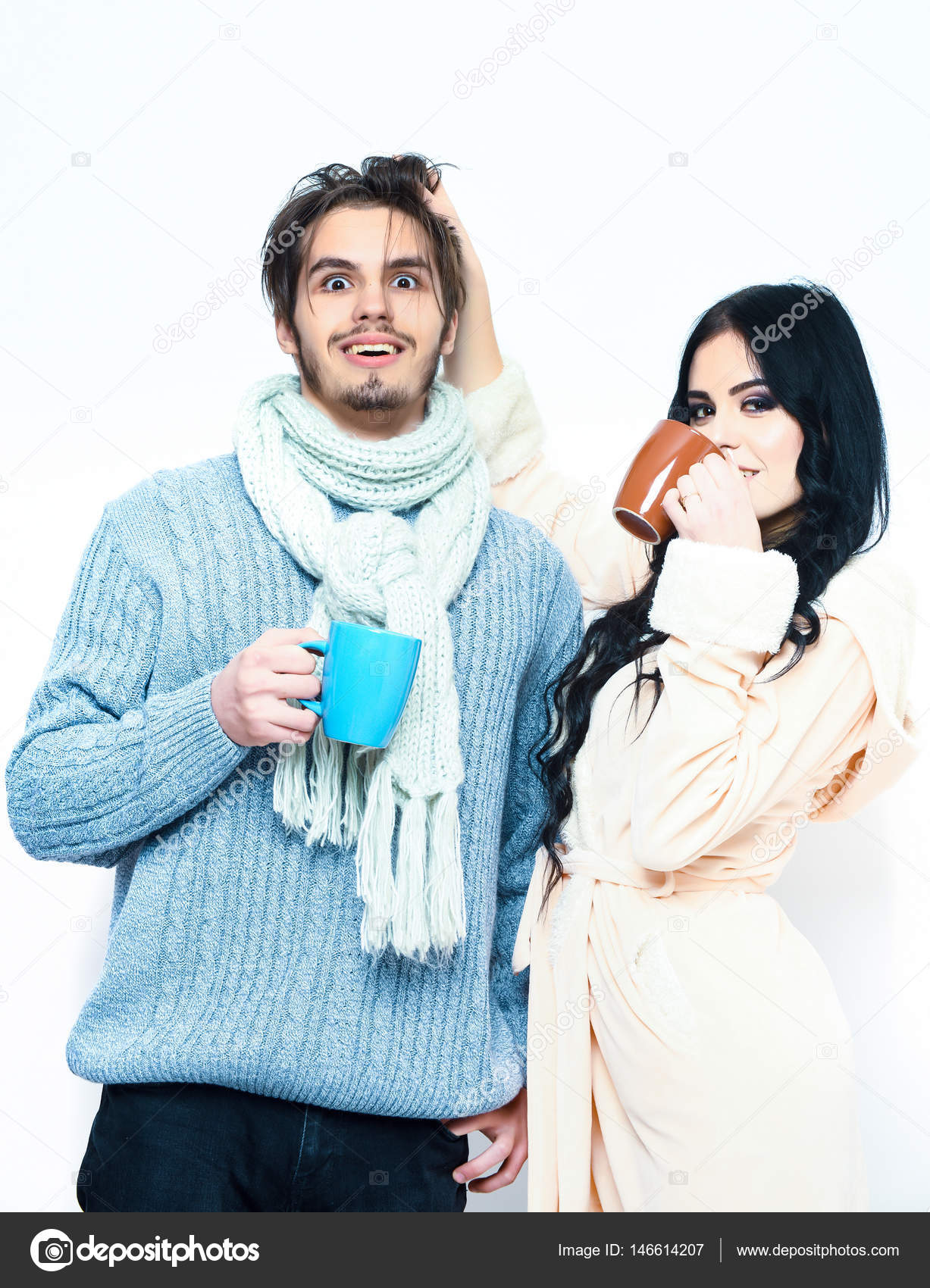 b7f40009dd Bearded caucasian surprised man with moustache in knitted blue sweater and  scarf with brunette pretty girl in beige robe drink coffee isolated on  white ...