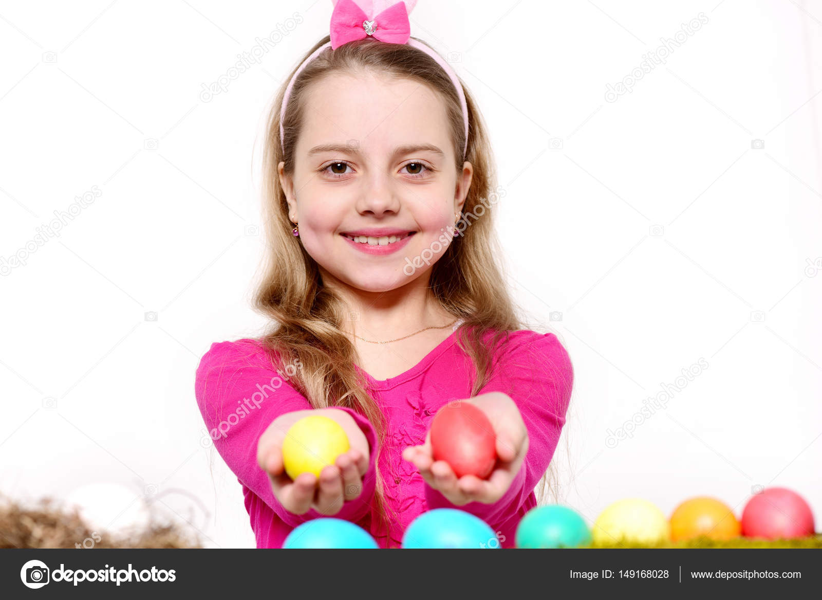 small happy baby girl with easter eggs isolated on white — stock