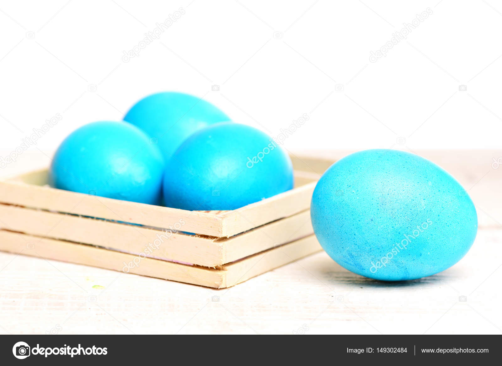 Traditional easter eggs painted in blue color in wooden box stock robin egg or eggshell blue traditional easter food painted in bright color in wooden box isolated on white background future life greeting and m4hsunfo