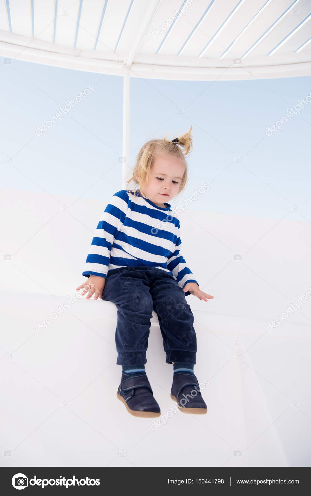 fashionable small baby boy on boat in marine shirt, pants — stock