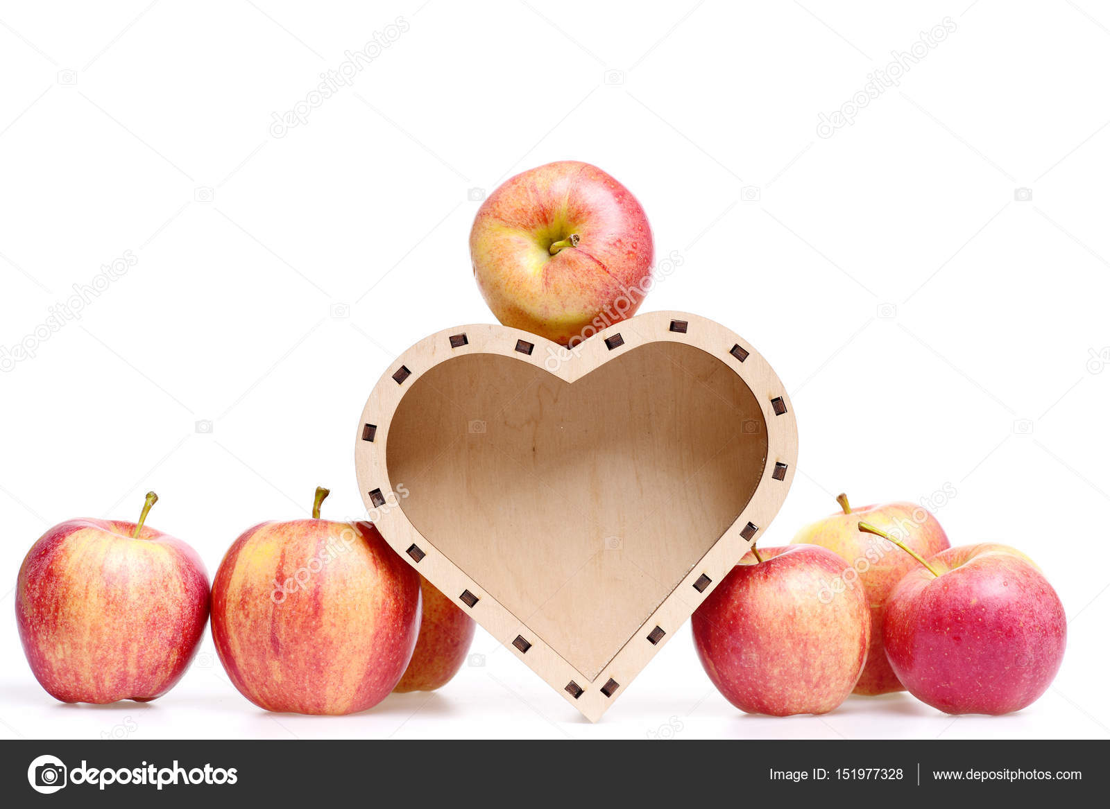 Apple fruit red color in wooden box in shape of heart stock wooden box in shape of heart as love symbol of valentines day holiday with apple fruit red color isolated on white background copy space photo by stetsik biocorpaavc