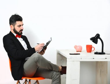 Bearded man, caucasian hipster with moustache at white wooden table