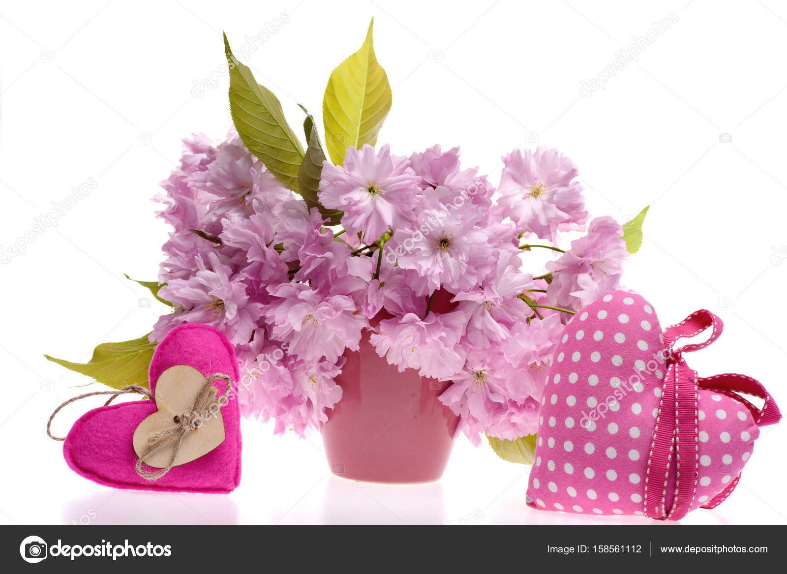 Toy Hearts In Pink Colour With Bunch Of Sakura Flowers Stock Photo