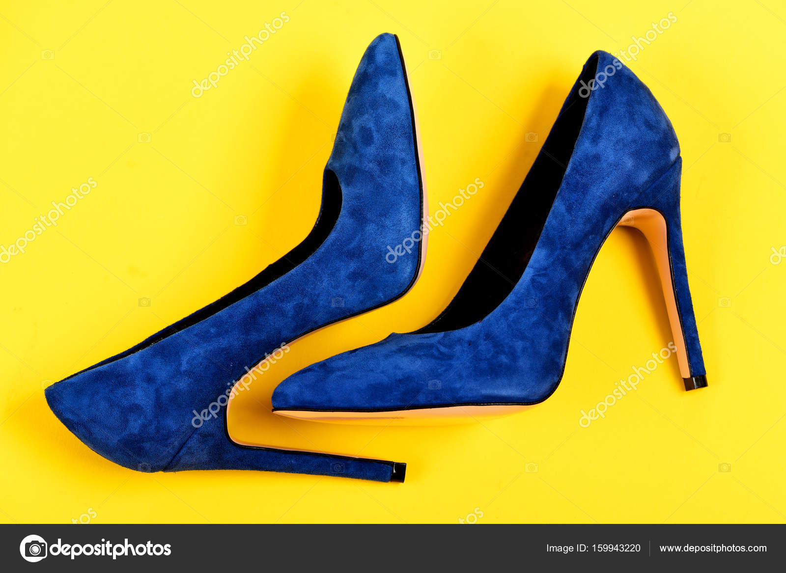 High Heel Footwear Isolated On Yellow Background Shoes In Dark Blue Color Elegance And Fashion Concept Pair Of Fancy Suede Female Top View Photo