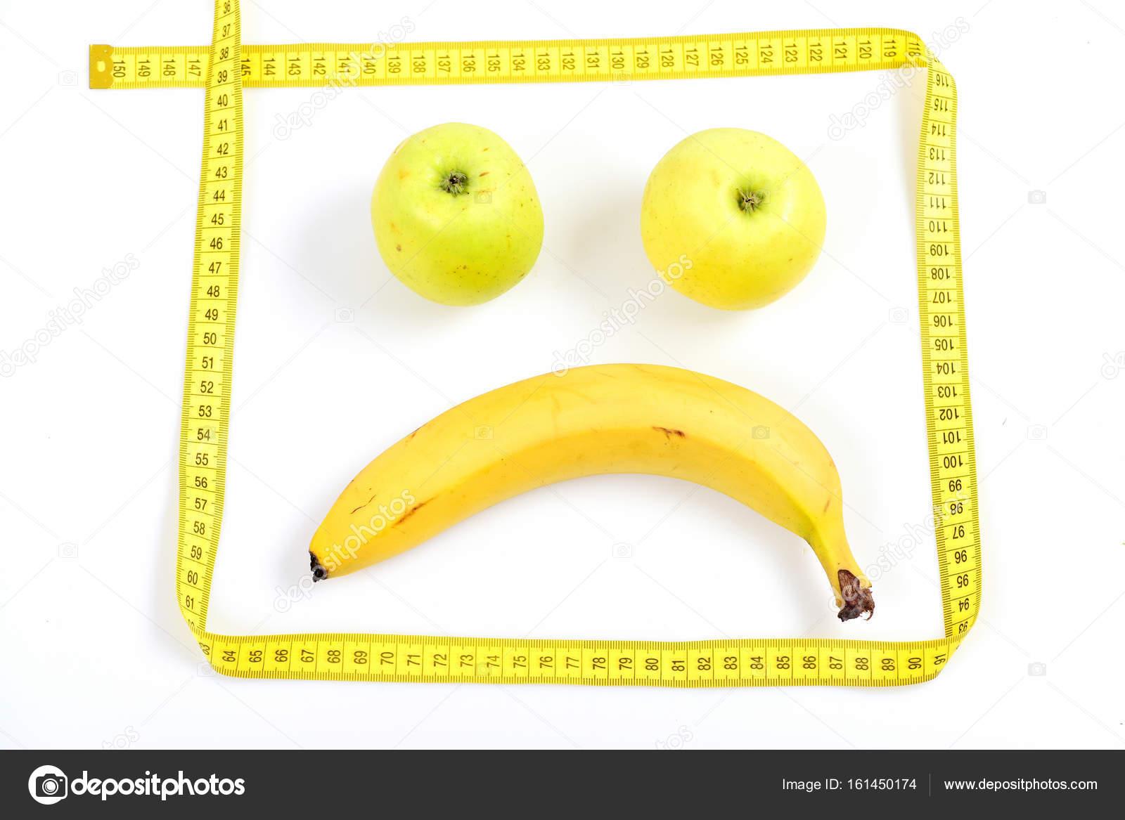 Marco hecho de medir la cinta y la cara de alimentos — Fotos de ...