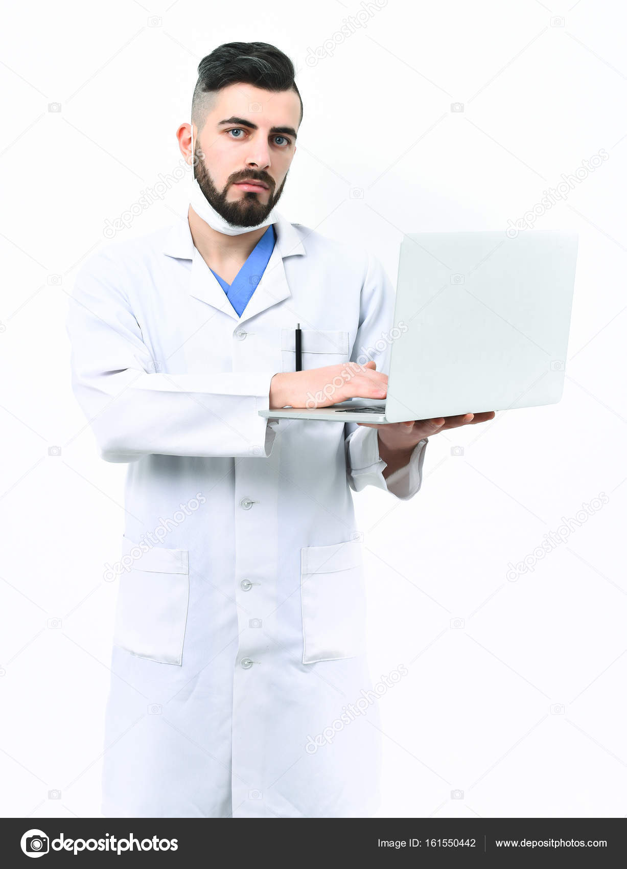 Man with serious face in white hospital gown. Treatment technologies ...