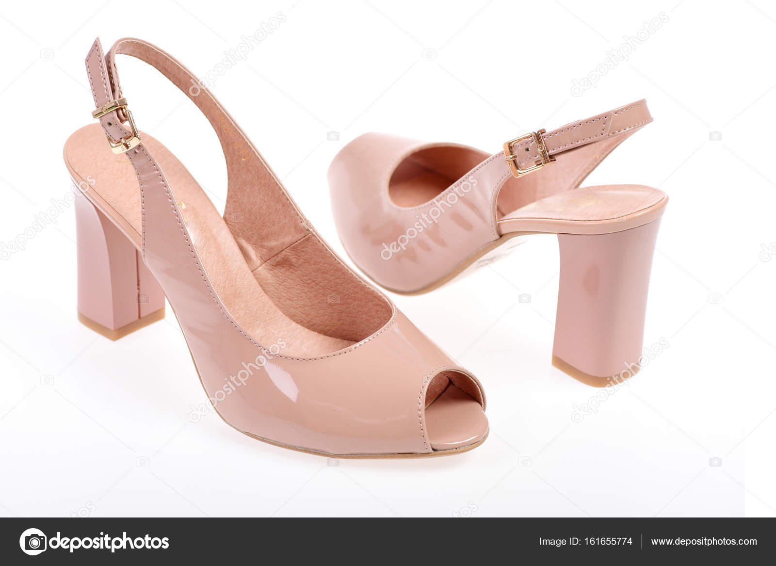 1805e7672a4 Female sandals isolated on white background. Fashion and beauty concept.  Womens patent leather shoes