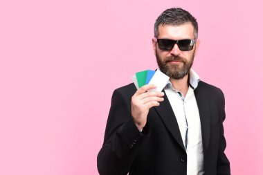 Businessman with empty cards, copy space. Guy with sunglasses