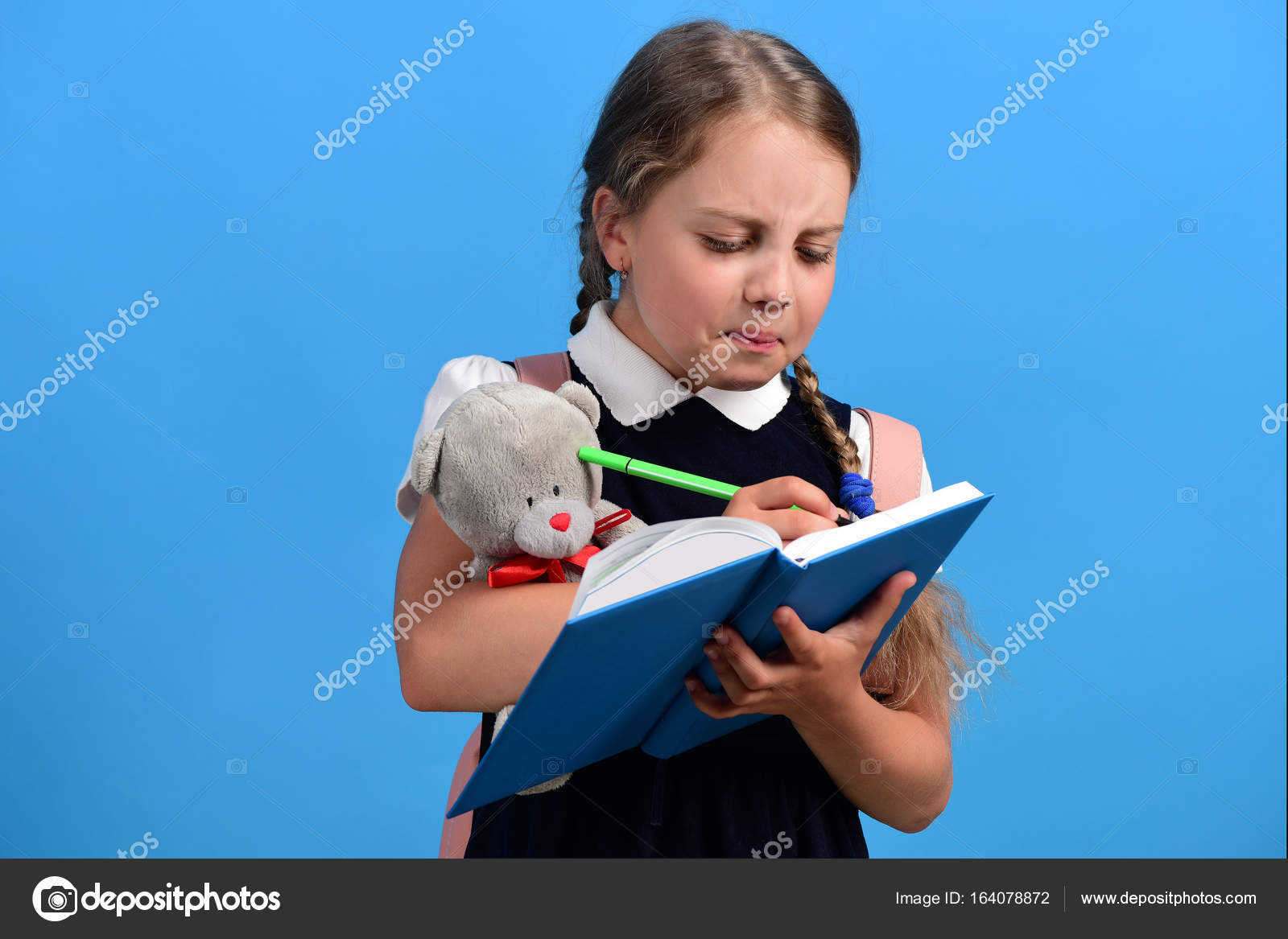 Pupil In School Uniform With Braids. Girl Holds Teddy Bear U2014 Stock Photo