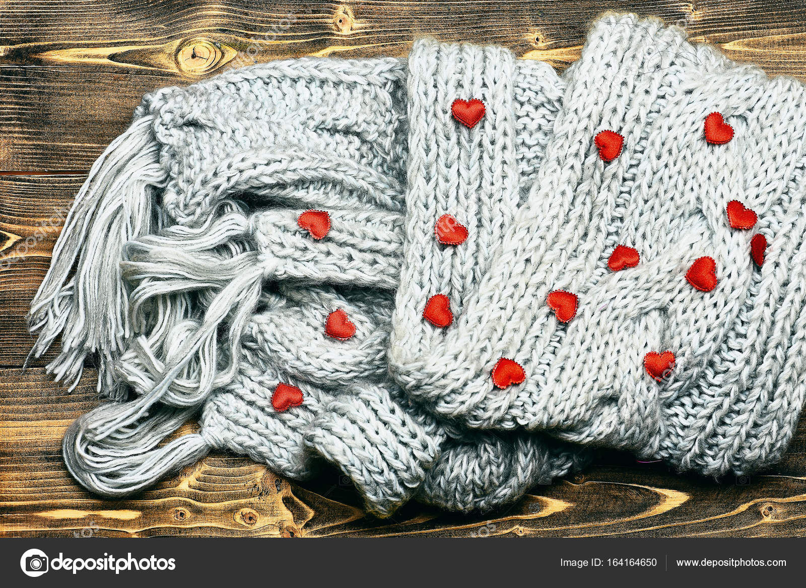 red valentines heart and grey knitted scarf on wood — Stock Photo ...