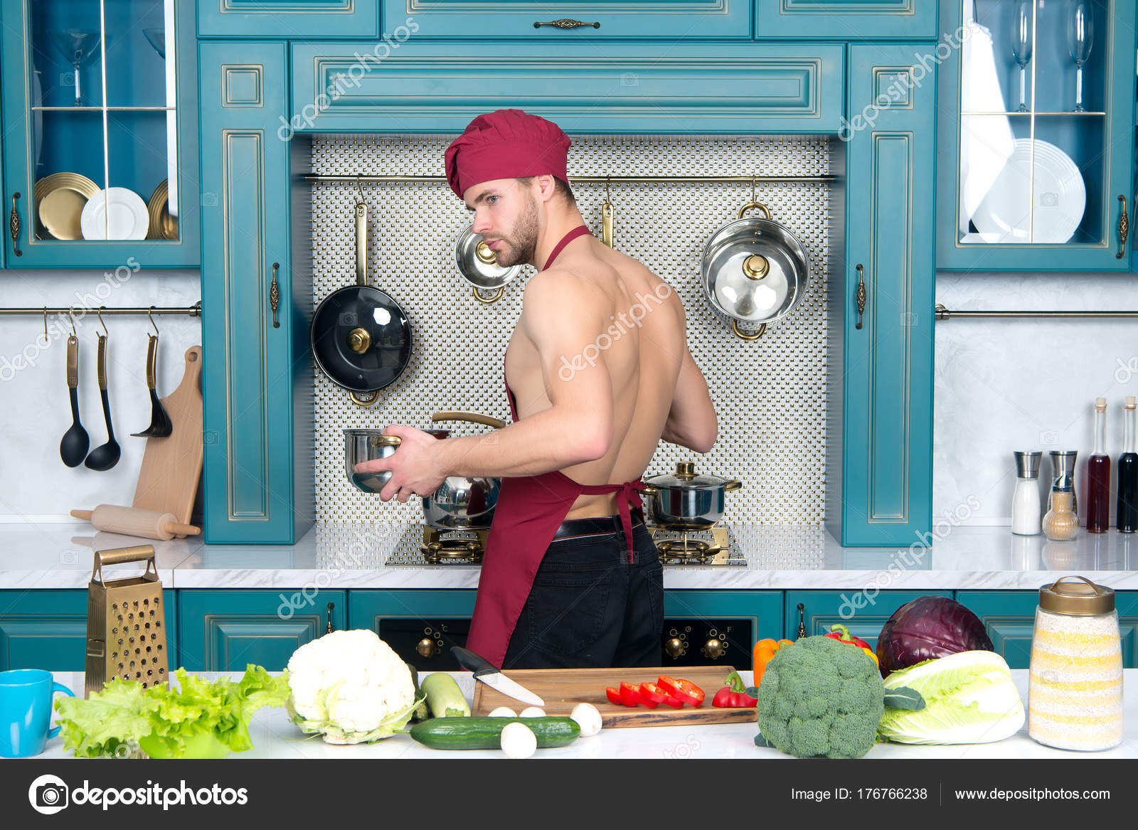 Guy in chef hat, apron cook in kitchen — Stock Photo © stetsik ...