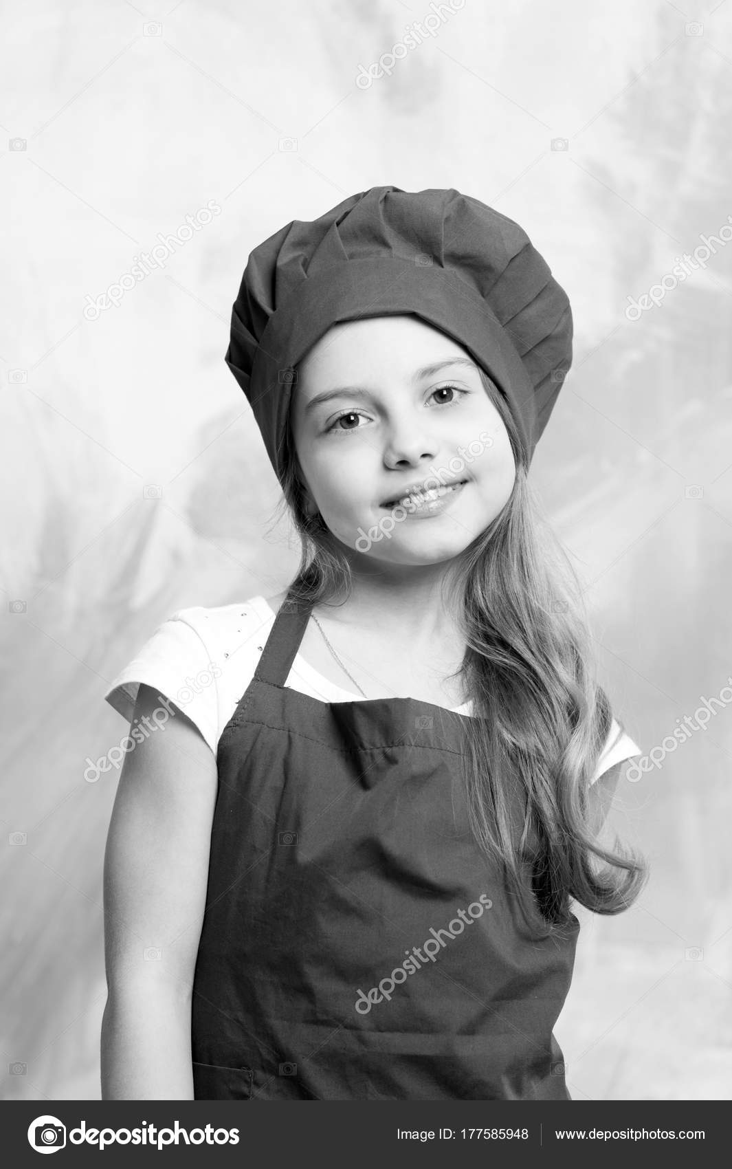 9a693cdf7d6 Small baby girl or cute child with happy face in red chef hat and cook apron  on colorful abstract background — Photo by stetsik
