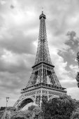 Fotografie Eiffel Tower at sunset in Paris, France. Romantic travel background. Eiffel tower is traditional symbol of paris and love.