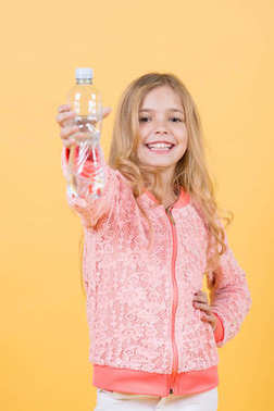 Drinking water concept. Drinking water in plastic bottle for small, little girl health.